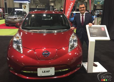 {u'en': u'Joni Paiva, president of Nissan Canada Inc., stands next to a Qualified Pre-Owned LEAF'}