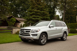 "The 2014 Mercedes-Benz GL 350 BlueTEC is more than just a people-hauler. Sure, it has three rows with room for seven, but it can also coddle you in creature comforts you might not expect from an automobile. As well as offering up ""slow and vigorous"" (should that be your desire) massaging front seats, the GL 350 is also quite quick for its size."