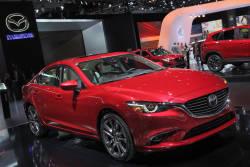 Voyez un bref aperçu vidéo du kiosque Mazda au Salon de l'auto de Los Angeles 2014 avec en autre les nouvelles Mazda6, CX-3 et CX-5 2016.