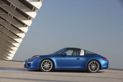 What began with great promise in 1965 has now been carried on in captivating style with the new 911 Targa 4 models. With the renaissance of the iconic Targa bar, innovative roof technology, an exceptional open-top driving feel and outstanding comfort. A sequel that is again taking place on the streets. The new 911 Targa 4 models.