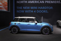 The new MINI Hardtop 4 Door made its North American premiere at the 2014 Los Angeles Auto Show. Yes, it's the same car that originally debuted at the Paris Motor Show in September as the MINI 5 Door. No, it didn't lose a door while crossing the Atlantic. The MINI Hardtop 4 Door offers seating for five and more cargo room than the regular Cooper while preserving its dynamic handling characteristics. Passengers also enjoy more room for their legs and shoulders.