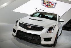 Equipped with a 3.6L twin-turbo V6 engine that produces 450 horsepower and 445 lb-ft of torque, the Cadillac ATS-V offers 6-speed manual and 8-speed automatic transmissions, a 50% firmer ride, Michelin Pilot Super Sport tires, and larger brakes. It also boasts a lower ride height, a heat extractor in the hood, as well as aggressive fascias. Cadillac will reportedly sell an optional package to add a different front, splitter, side skirts and rear spoiler for extra downforce at speed.