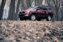 The 4Runner's lumpy skin is host to numerous truck-ish styling cues, including plastic fender flares, running boards and a high ground clearance.