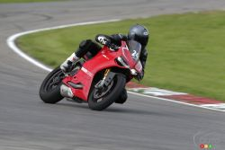 While there's no rule against letting it rip on the open road, the 2013 Ducati 1199 Panigale R is definitely more geared for the track and superbike races. Like a thoroughbred, it must be understood, caressed, and mastered in order to complete hot laps and post satisfyingly quick times.