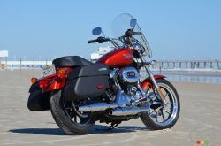The 2014 Harley-Davidson SuperLow 1200T is a more muscular, touring-oriented version of the SuperLow 883, with a pair of lockable saddlebags, a removable Switchback-style windshield, a more comfortable seat, as well as available antitheft alarm and keyless start. It revives an idea dropped more than 50 years ago: building a Sportster for light touring.