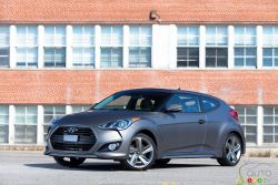 Fun and practical - Full of interesting lines, angles, and nooks and crannies, the 2013 Hyundai Veloster is not your average hatchback when it comes to exterior design. From the gaping front grille, to the eye socket-like taillights and dual exhaust, the Veloster is a looker.