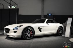 """The all-important AMG logo now features """"GT"""" letters - What physically distinguishes the GT from the base model are smoked headlights and taillights. Other stunning details include matte black 10-spoke wheels (19"""" front, 20"""" rear) which partially hide red brake callipers. Also, the hood, fenders and front grille fins along with the side-view mirrors all have a glossy finish."""