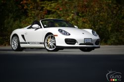 The Boxster Spyder is an amazingly hot roadster. This two-seater is the featherweight member of the Porsche line up, weighing in at just 1,275kgs. The Spyder is 80 kg lighter than the Boxster S.	 The doors are aluminum and the 19-inch wheels are the lightest that Porsche makes. The biggest cut in weight has come from removing the fully powered, twenty-one kilogram retractable softtop from the Boxster S and replacing it with a very light canvas style roof. It weighs just seven kilograms!