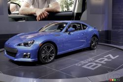 Sounds perfect - The 2013 Subaru BRZ is rear-wheel-drive, has a high-strung 2.0L 4-pot good for 200 ponies and a 6-speed manual gearbox. The BRZ is as fast as it looks, capable of reaching 100 km/h in about 6 seconds. The cockpit is designed for a driver and a navigator, and refinement is kept to a minimum.