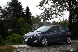 The Elantra GT has the ammo to battle its foes - The 2013 Hyundai Elantra GT rides on a shorter wheelbase than the sedan; it is also shorter overall, with a slightly higher roofline. The basic shape is pretty similar to the sedan and coupe, with its prominent crease that flows over the front fender and rises along the car's flanks, cleverly trying to conceal the door handles.