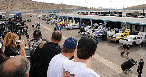 NASCAR fans watch the race teams prepare for days testings.