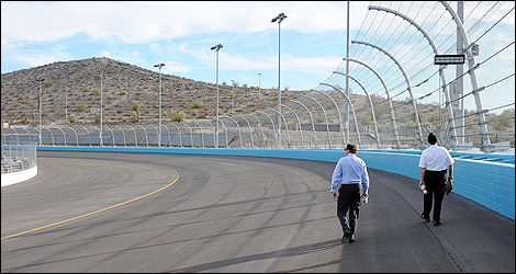 Robin Pemberton and Dave Handy walk the new backstretch at Phoenix International Raceway.