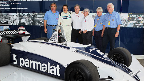 Past Brabham owner Bernie Ecclestone with Nelson Piquet, former team mechanics and the BT 49.