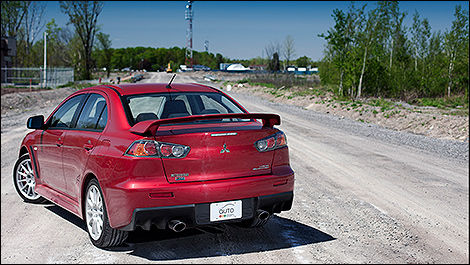 2012 Mitsubishi Lancer Evolution rear 3/4 view