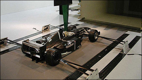 Scale model of a Formula 1 car being tested in the wind tunnel.