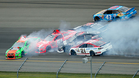 Danica Patrick, driver of the No. 10 GoDaddy Chevrolet triggered a pile-up.