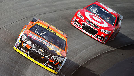 Jeff Gordon fighting against Kyle Larson.