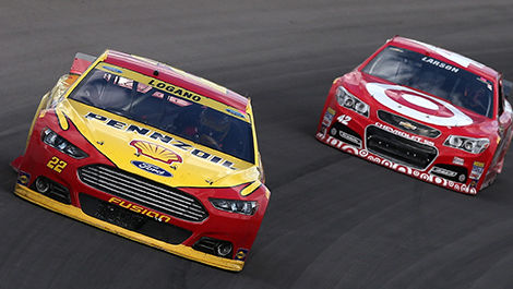 Joey Logano, driver of the No. 22 Shell-Pennzoil Ford, leads Kyle Larson, driver of the No. 42 Target Chevrolet.
