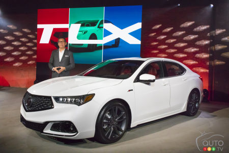 Jon Ikeda, Acura vice president and general manager, poses next to the new 2018 Acura TLX