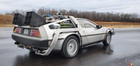 The replica of Doc's DeLorean, three-quarters rear