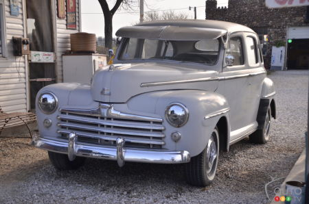 Classic car residing at the Sinclair Gay Parita gas station