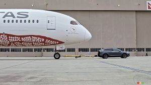 Watch as a Boeing 787 Dreamliner gets towed by… a Model X