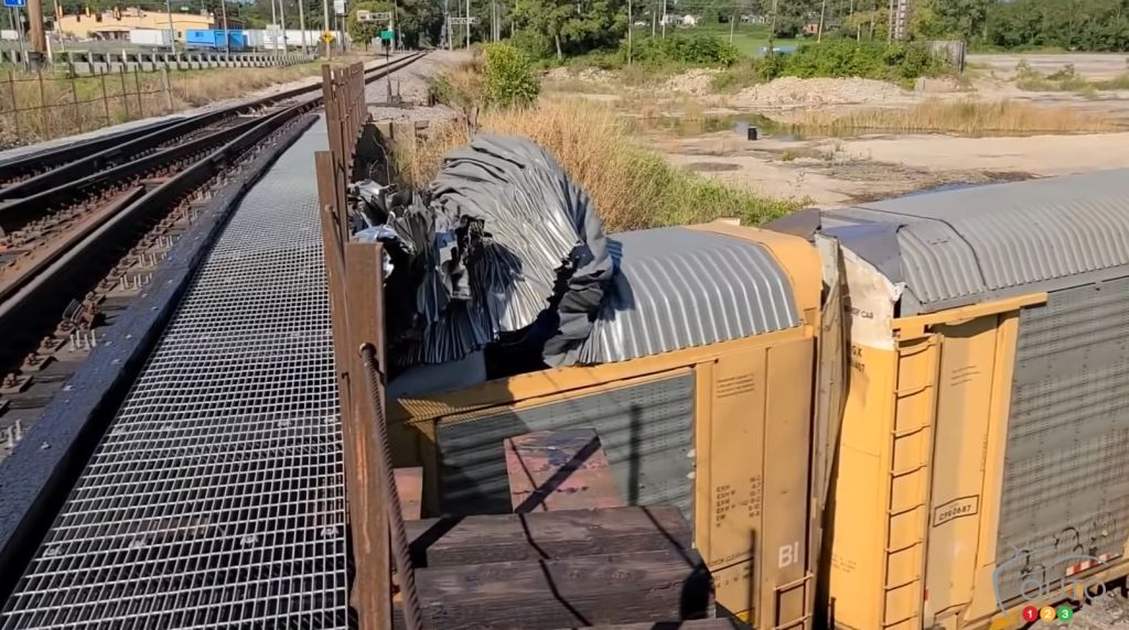 Low Bridge Opens Up Tops of Train Cars Like Sardine Cans, Destroys New Vehicles Within