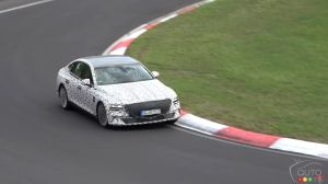 An electric-powered Genesis G80 in testing on the track at Nürburgring