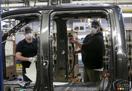 Workers in a Ford plant