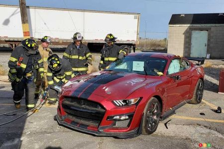 Firefighters preparing the  Shelby GT500