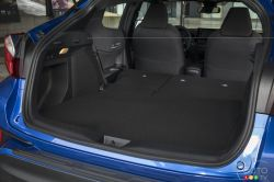 Trunk with folding rear seat