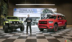Pietro Gorlier, Head of Parts and Service (Mopar) showcases customized versions of the all-new Jeep Wranger and the 2019 Ram 1500 at the Chicago Auto Show.