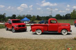 Two generations of Ford trucks